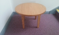 Circular coffee table, for use with tub chairs